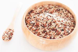 Organic dry multi-grain rice in a wooden bowl
