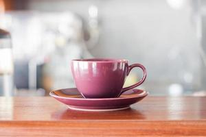 Purple coffee cup in coffee shop