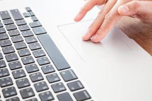 Close-up of a person using a laptop