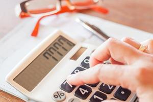 Businesswoman working with a calculator photo