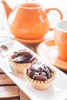 juego de té de naranja y tartas