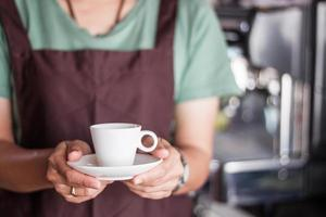 Person holding a cup of coffee