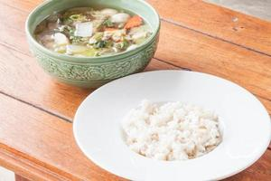 Soup and rice on a table