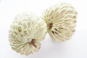 Two custard apples on a white background photo