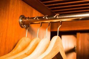 Empty wooden hangers photo