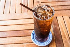 Iced soda on a wooden table photo