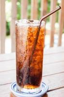 Glass of iced cola photo