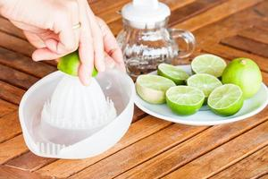Hand squeezing fresh lime juice