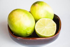Fresh limes in a ceramic bowl