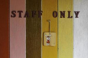 Staff only sign on a painted wall