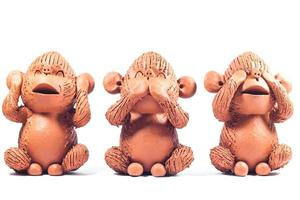 Three clay monkeys on a white background