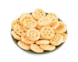 Salty wheel snacks on a green plate