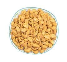 Top view of masala peanuts in a clear bowl