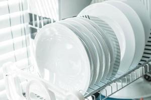 White clean dishes on a dish rack