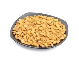 Masala peanuts on a black square plate