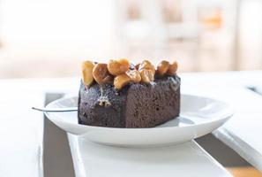 Macadamia chocolate cake on minimal white background