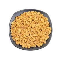 Top view of masala peanuts on a black plate