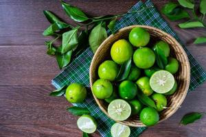 Green limes in a basket