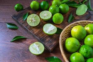 Fresh limes in green basket