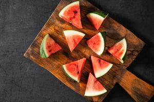 Fresh water melon slices on a wooden cutting board