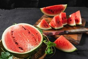 Sliced watermelon on a cutting board