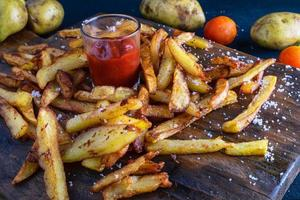 Homemade baked potato fries with ketchup