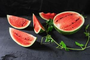 Slices of watermelon on black background
