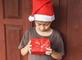 Boy with gift box on Christmas day