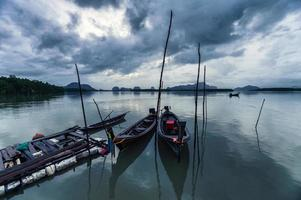 Wooden long tail boats photo