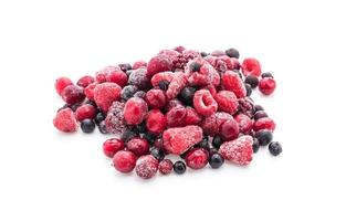 Frozen mixed berries on white background photo