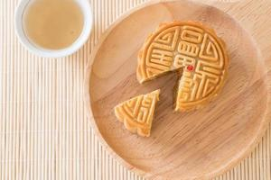 Fresh moon cakes on wooden background