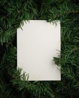 Creative layout made of leaves with paper card note photo