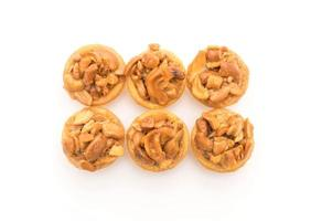Toffee cupcakes on white background