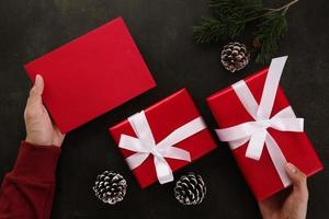 Hands holding red greeting card mockup