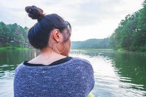 Woman in hoops in a boat