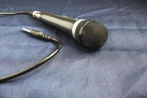 Microphone on a black background photo