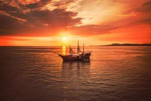 Sailing ship on calm water