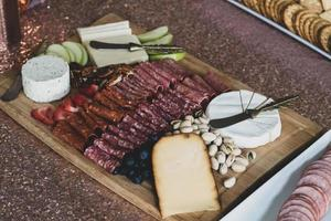 Charcuterie board with nuts photo