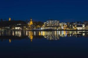 Waterfront city skyline at night