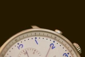 Close-up photo of gray chronograph watch