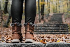 Woman's legs wearing winter shoes
