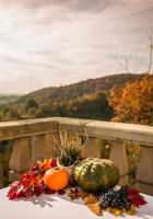 Autumn decor on an outdoor table with a view