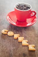 Coffee alphabet biscuits with coffee beans in a cup