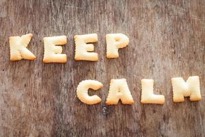 Keep calm alphabet biscuits on a wooden table
