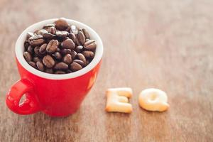 EQ alphabet biscuits with a red coffee cup
