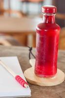 Red soda in a glass bottle