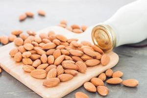 Almond nuts on and milk photo