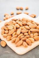 Almond nuts on a wooden board photo
