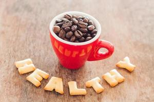 Healthy alphabet biscuits with a red coffee cup