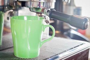 Green coffee mug in coffee shop